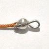 Sterling silver knot holding open crimps 1+ gram